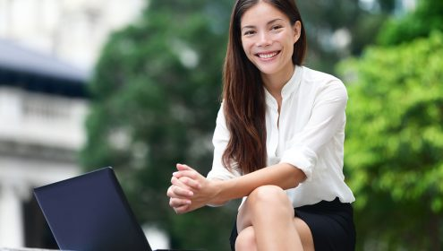 Business people - woman on laptop in Hong Kong. Businesswoman on